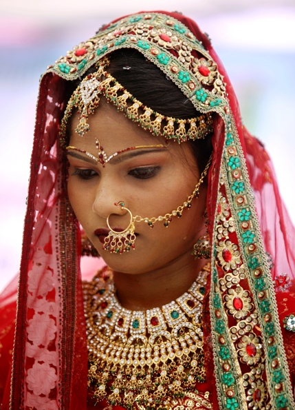 A bejewelled bride attends a mass marriage ceremony in Ahmedabad.