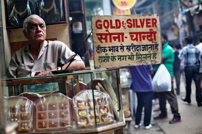 A shopkeeper waits for customers at his gold and silver jewellery shop in the old quarters of Delhi.