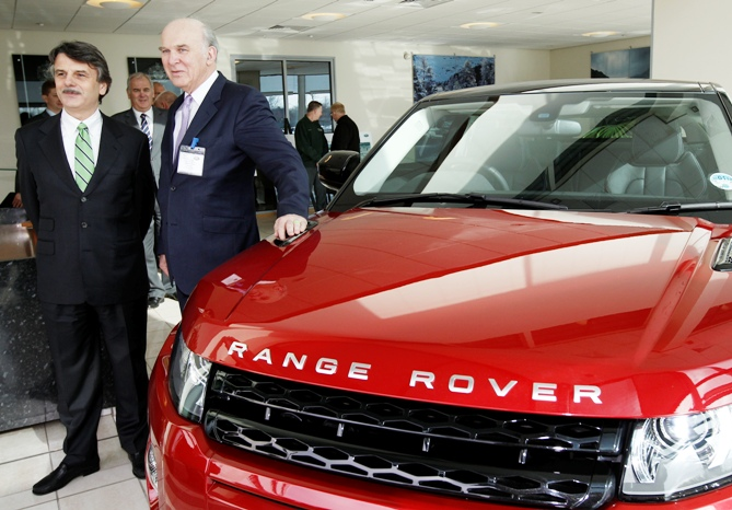 Britain's Business Secretary Vince Cable (R) looks at the new Range Rover Evoque model with company CEO Ralf Speth during a visit to Jaguar Land Rover's Halewood assembly plant, in Liverpool, northern England.