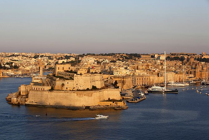 A boat sails past the medieval Fort Saint Angelo in Vittoriosa in Valletta's Grand Harbour.