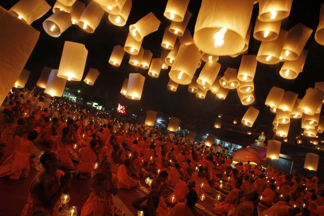 Buddhist monks release paper lanterns into the sky in Suphan Buri province.