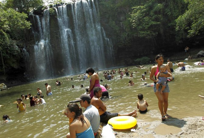 People take a bath in the Llanos del Cortes waterfall Bagaces, Guanacaste city.