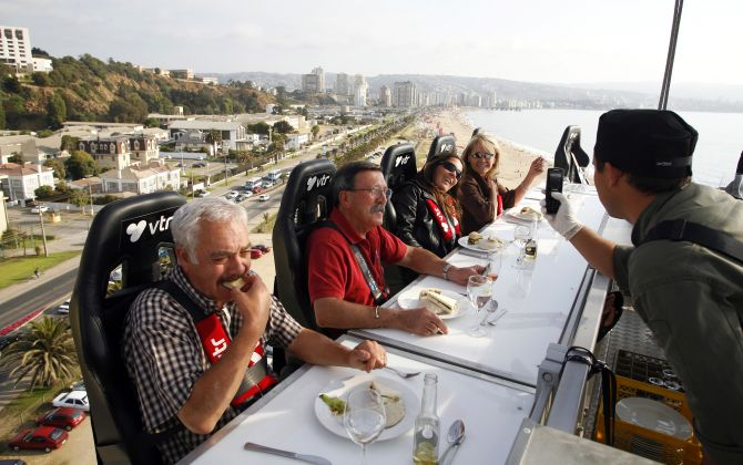 Guests have dinner at a event known as Dinner in the Sky as they are seated around a table that is lifted by a crane in Vina del Mar city, about 75 miles (120 km) northwest of Santiago.