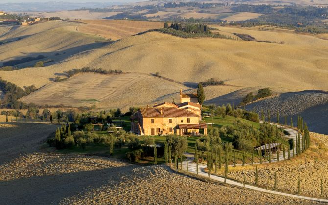 A house is seen in the fields of the Crete Senesi (Siennese clays) area near Asciano.