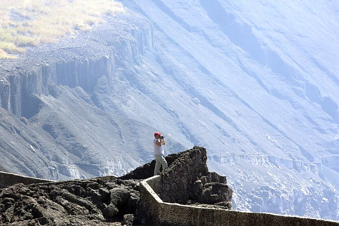 A tourist takes pictures at the Santiago Volcano National Park also known as Masaya Volcano.