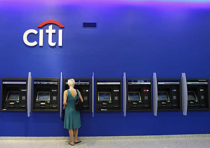 A woman uses an ATM inside a Citi bank branch in New York City.