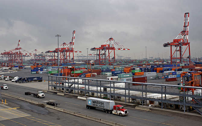 Trucks pass the Port Newark Container Terminal near New York City in Newark, New Jersey.