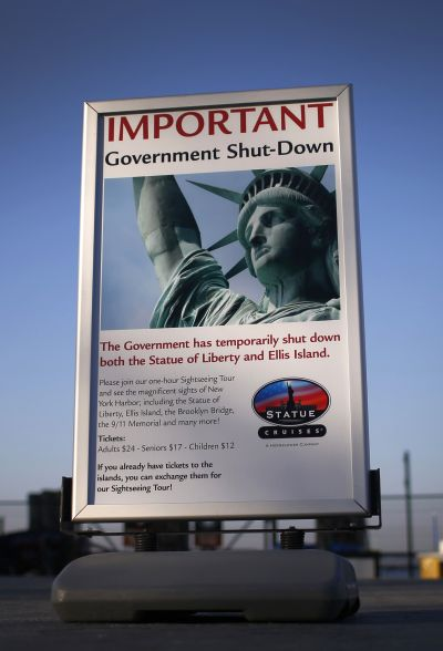 A sign announcing the closure of the Statue of Liberty, a US National Park, due to the US Government shutdown stands near the ferry dock to the Statue of Liberty in Battery Park in New York.
