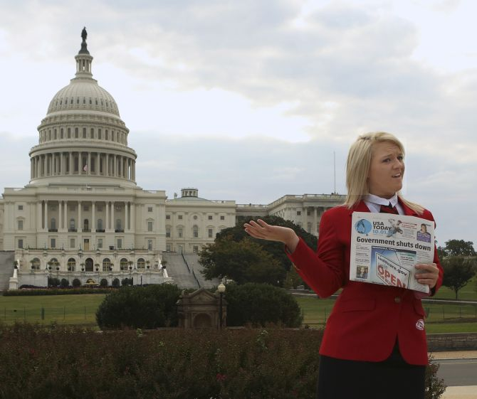 Abigail Welch, a member of the Family, Career and Community Leadership of America group, poses in front of the US Capitol in Washington on day one of the government shutdown.