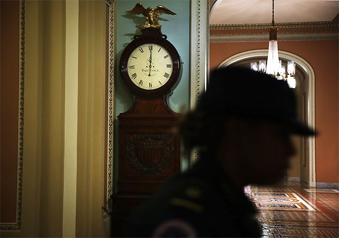 A Capitol Hill Police officer passes by the Ohio Clock.