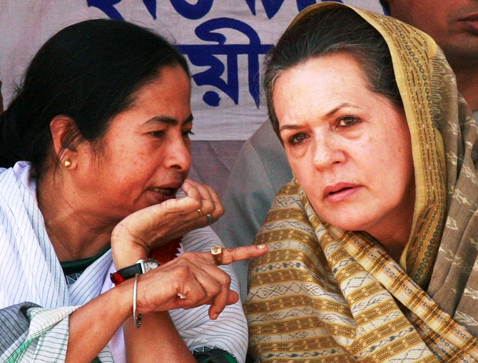 This file photograph shows chief of Congress party Sonia Gandhi (right) listening to West Bengal Chief Minister and Trinamool Congress chief Mamata Banerjee during an election campaign rally in Lalgola on April 27, 2009.