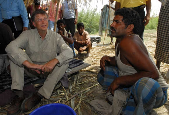 Microsoft co-founder Bill Gates interacts with a villager in Aulali village in Khagaria district, Bihar.