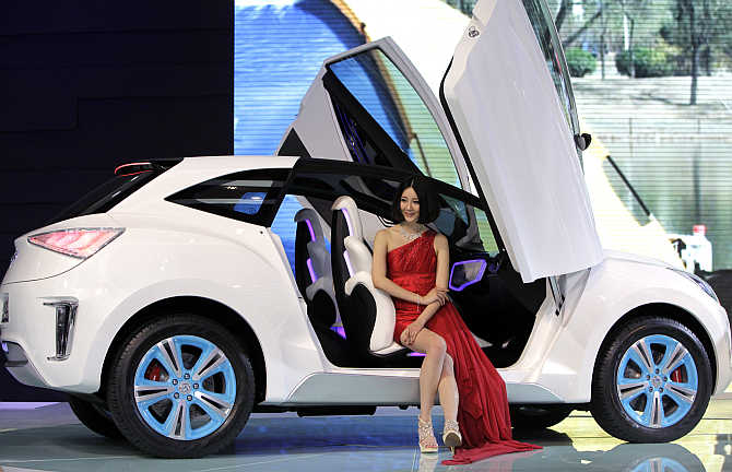 A model sits in a Haval E concept car in Beijing.