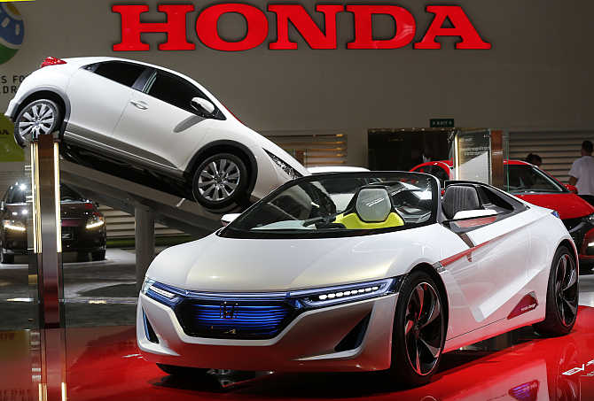 Honda roadster EV-Ster electric car on display in Paris.