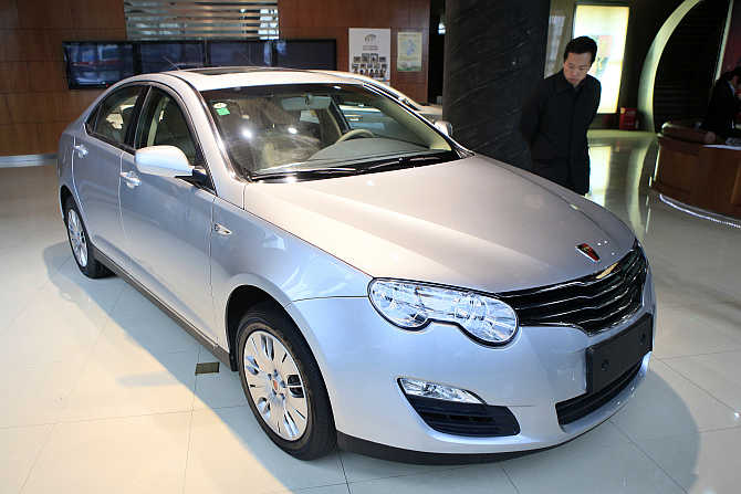 A customer looks at a Roewe 550 car at a Chinese automaker Saic Motor Corporation dealership in Shanghai.