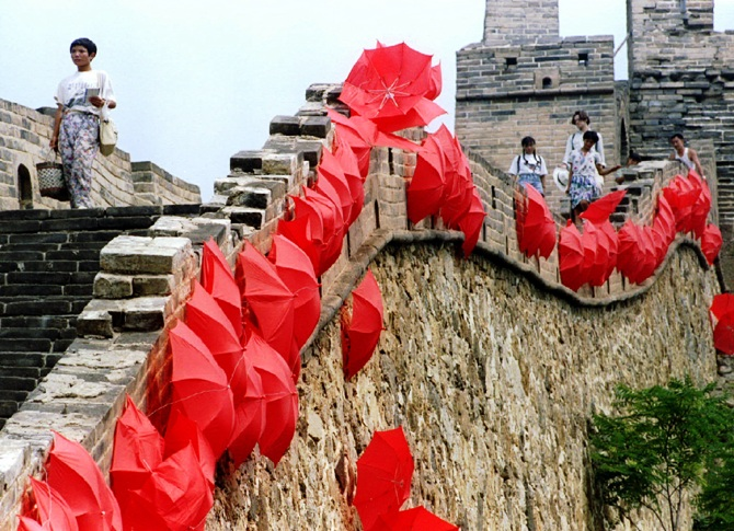 Tourists stroll on The Great Wall lined with red umbrellas at Si Ma Tai, north of Beijing.