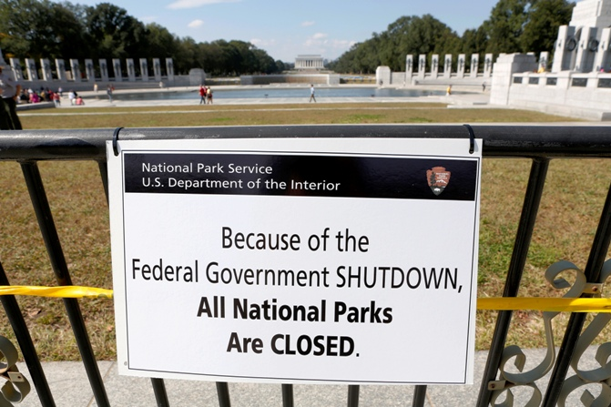 A closure sign is seen on a barricade at the World War Two Memorial in Washington.