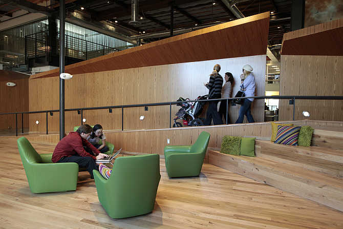 Employees sit in the 'Boardwalk' workspace at the Google campus near Venice Beach, in Los Angeles, California.