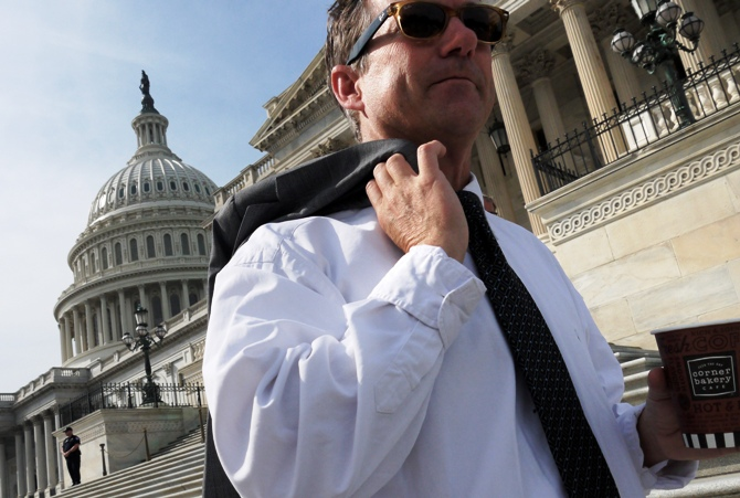 US Senator Rand Paul departs after a photo opportunity where he invited fellow legislators to have coffee on the steps of the U.S. Capitol during the government shutdown in Washington, on October 3, 2013.