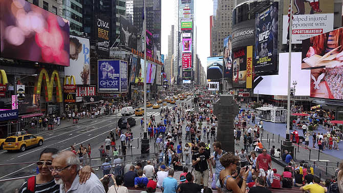 Tourists gather in Times Square in New York, United States.