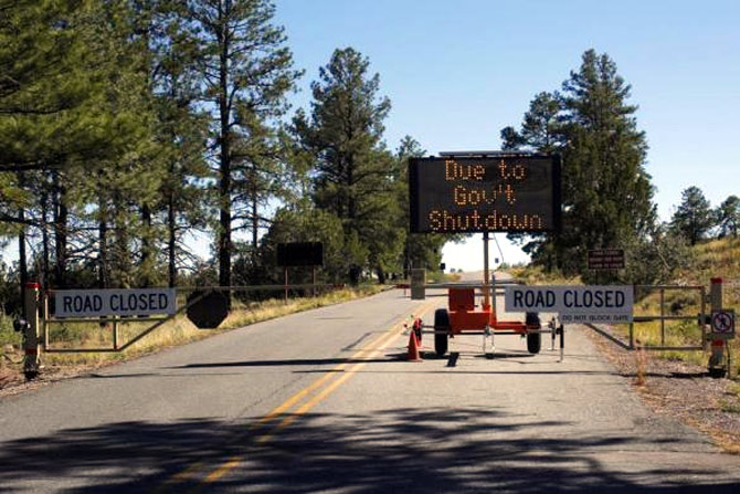 A sign at the entrance to Bandelier National Monument in New Mexico announces its closure.