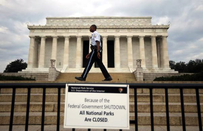 A National Parks policeman walks past a sign after the Lincoln Memorial was sealed off from visitors in Washington.