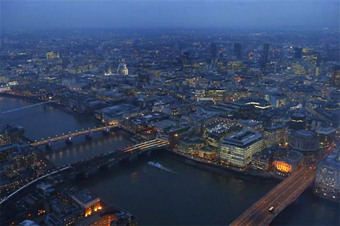 St Paul's cathedral and the financial district are seen at dusk in an aerial photograph from The View gallery at the Shard, western Europe's tallest building, in London.