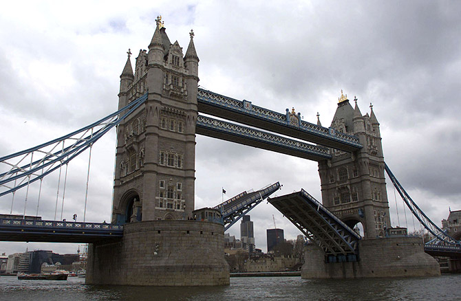 Tower Bridge closes after a tall ship has past through it.