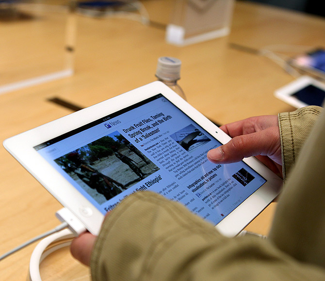 A customer works on the new iPad at the Apple flagship retail store