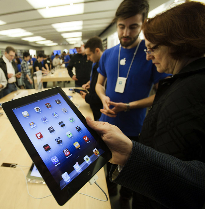 Customers look at the the new iPad at the Apple Store