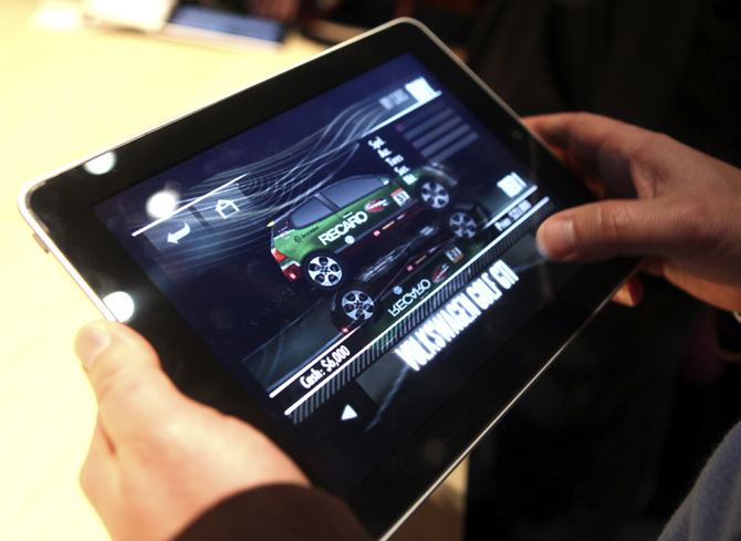 A video game is displayed on Apple's  iPad , a new tablet computing device