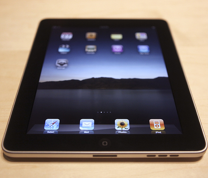 The Apple  iPad , a new tablet computing device, sits on display