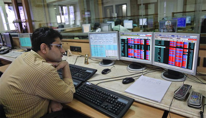 Sensex ends below 21,100 mark; Q3 nos disappoint