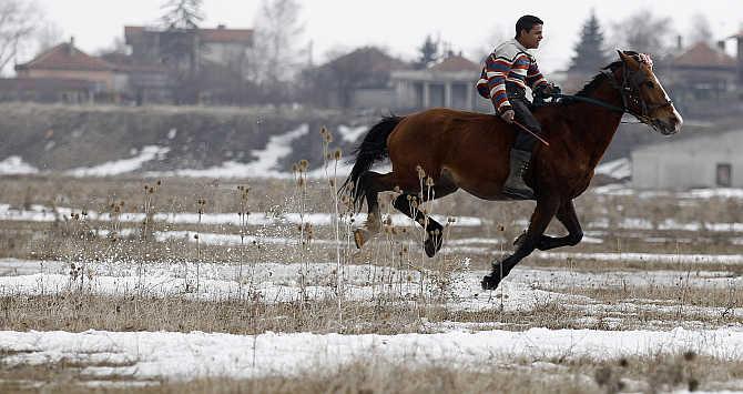 A man rides a horse near Sofia, Bulgaria.