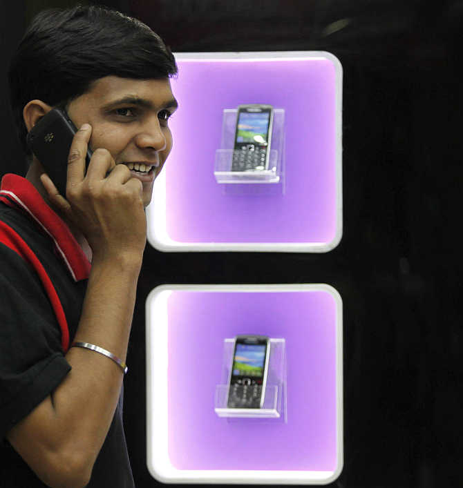 A man speaks on a mobile phone in Kolkata.