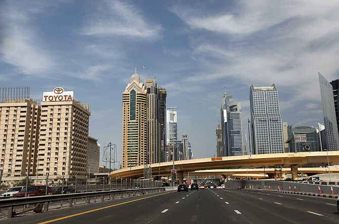 High-rise residential and office towers are seen near Sheikh Zayed Road in Dubai, United Arab Emirates.