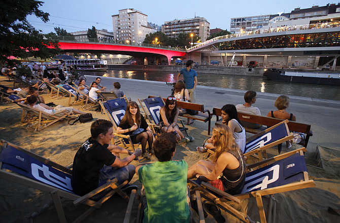 People enjoy the evening at Donaukanal in the centre of Vienna, Austria.