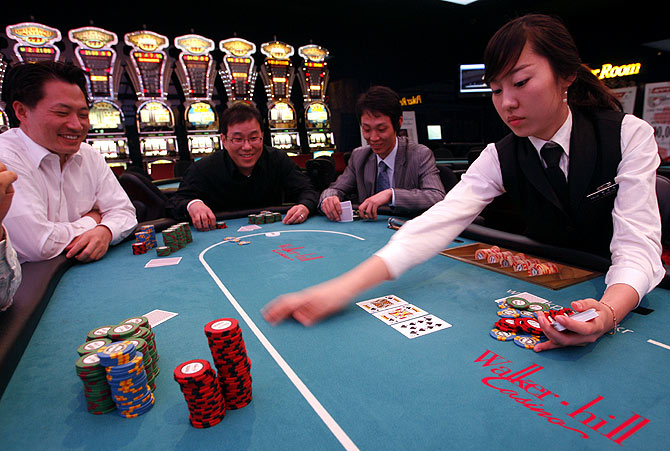 Men play poker at the Paradise Walker-hill casino in Seoul.
