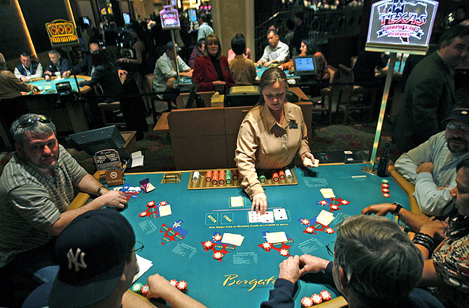 A dealer works at a poker table at the Borgata casino in Atlantic City, New Jersey.