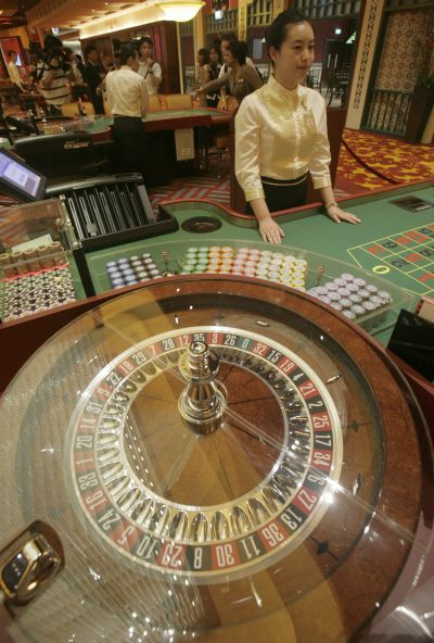 A croupier waits for gamblers at a table