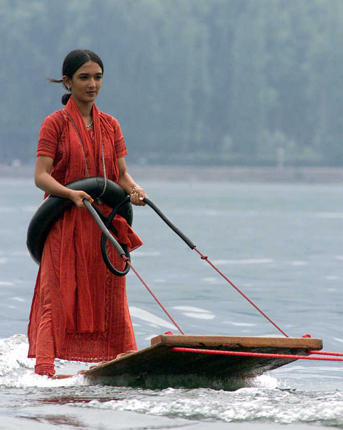 A tourist enjoys water surfing on Dal Lake in Srinagar.