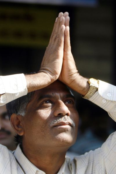 An investor gestures with folded hands towards the Bombay