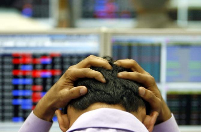An Indian broker reacts while trading at a stock brokerage firm in Mumbai.
