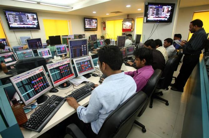 Stock brokers trade in a brokerage firm in Kolkata.