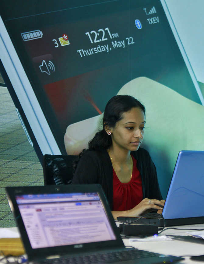 An employee works on her laptop at the Start-up Village in Kinfra High Tech Park in Kochi.