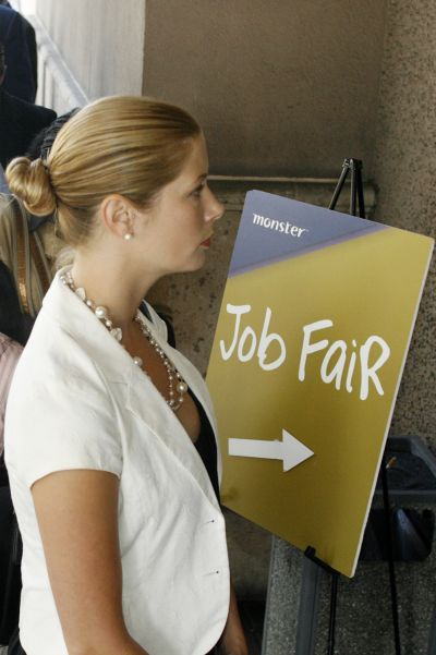 A candidate waits in the line to enter a job fair.