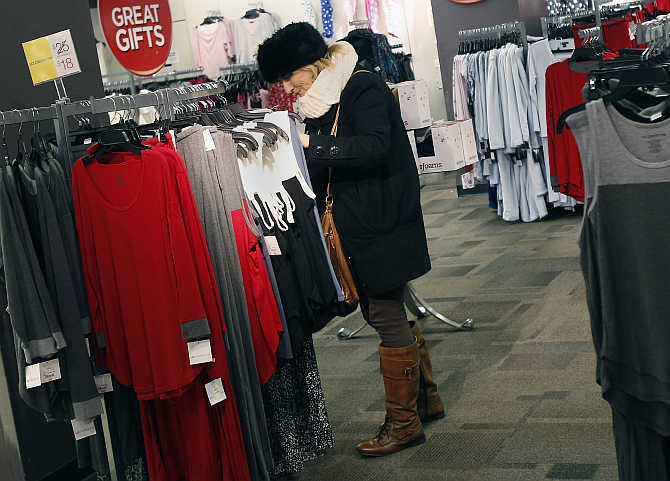 A woman shops for jeans at a JC Penney store in New York City.
