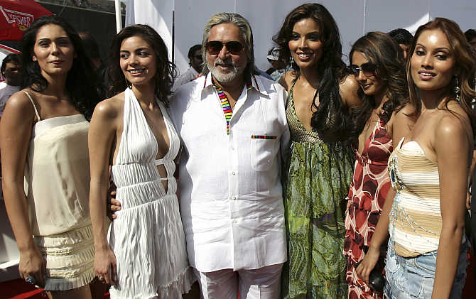 Vijay Mallya with models at a function in Mumbai.