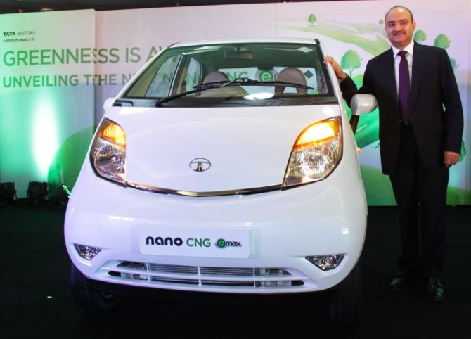 Ankush Arora, Senior Vice-President and Head-Strategy, Tata Motors Ltd, unveils Nano CNG version in Ahmedabad.