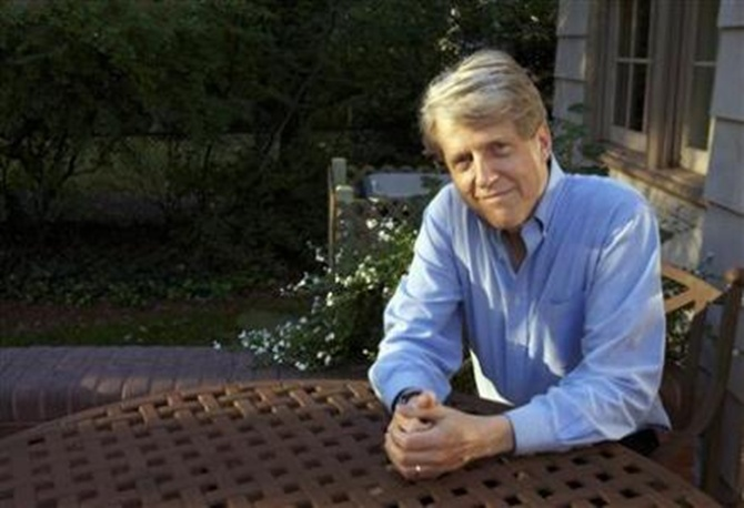 Robert Shiller, one of three American scientists who won the 2013 economics Nobel prize, poses at his home in New Haven, Connecticut.
